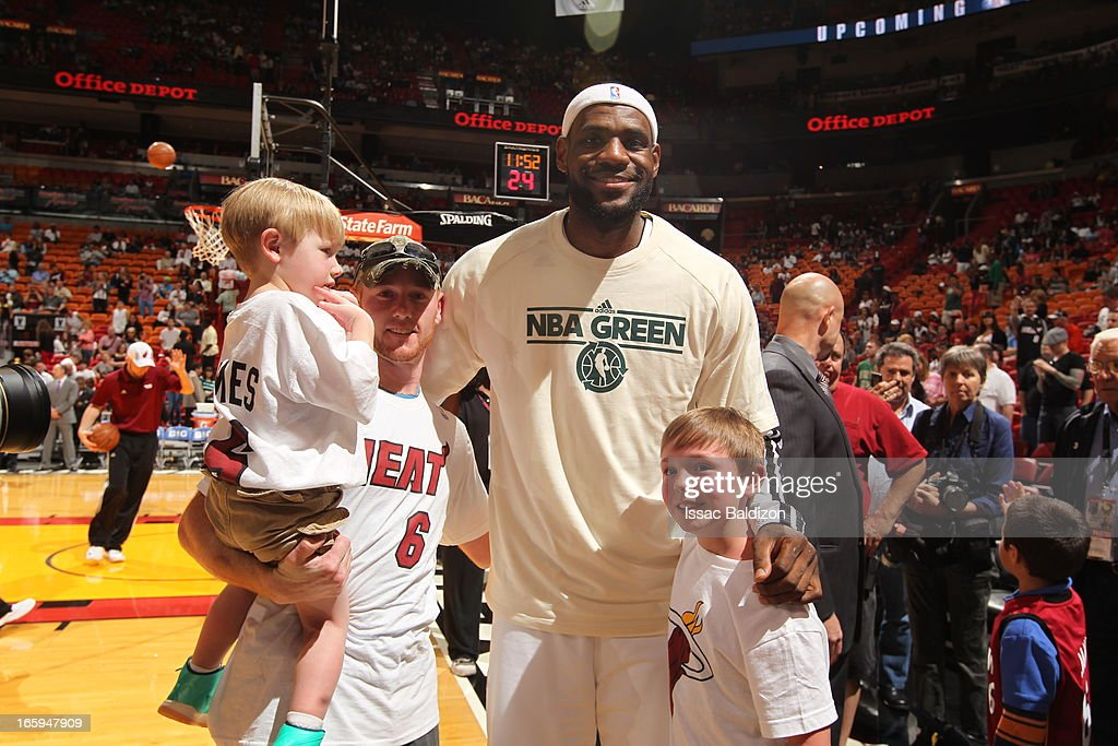 LeBron James #6 of the Miami Heat meets Cayden And Conner Long, Sports Illustrated's Sportkids of the Year, during a game between the Philadelphia 76ers and the Miami Heat on April 6, 2013 at American Airlines Arena in Miami, Florida.