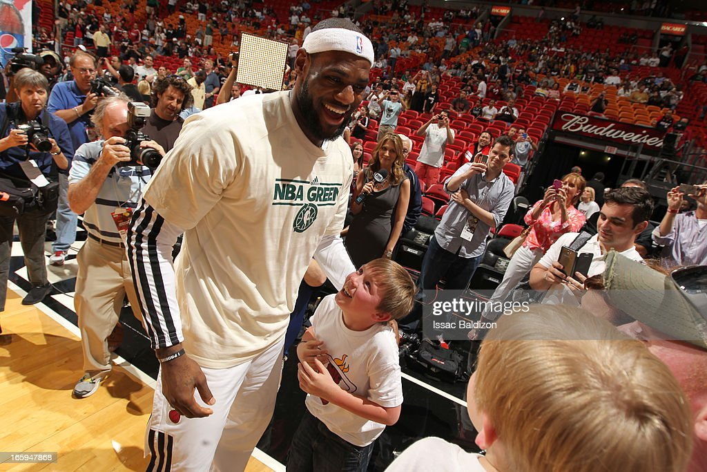 <a gi-track='captionPersonalityLinkClicked' href=/galleries/search?phrase=LeBron+James&family=editorial&specificpeople=201474 ng-click='$event.stopPropagation()'>LeBron James</a> #6 of the Miami Heat meets the Sports Illustrated's Sportkid of the Year during a game between the Philadelphia 76ers and the Miami Heat on April 6, 2013 at American Airlines Arena in Miami, Florida.