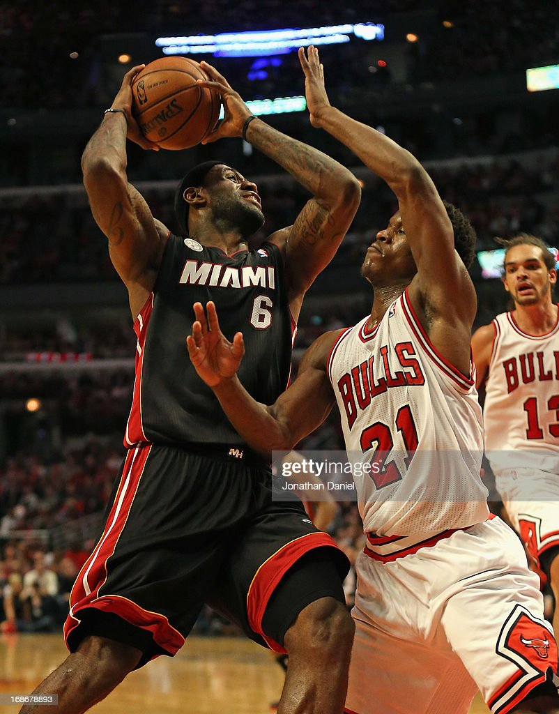 LeBron James #6 of the Miami Heat moves against Jimmy Butler #21 of the Chicago Bulls in Game Four of the Eastern Conference Semifinals during the 2013 NBA Playoffs at the United Center on May 13, 2013 in Chicago, Illinois.