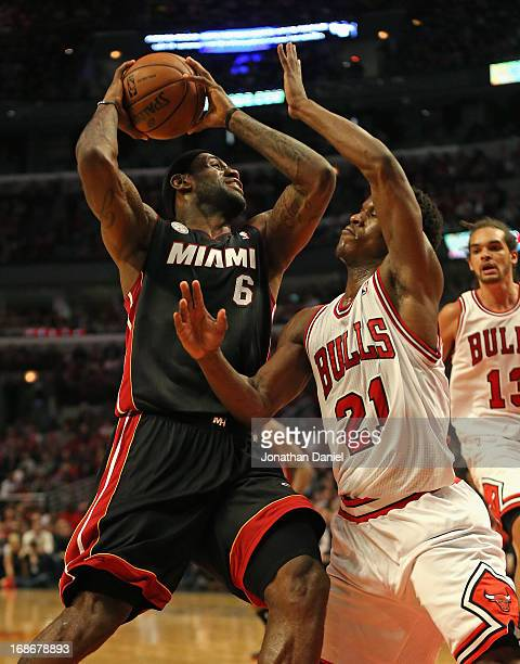 LeBron James of the Miami Heat moves against Jimmy Butler of the Chicago Bulls in Game Four of the Eastern Conference Semifinals during the 2013 NBA...