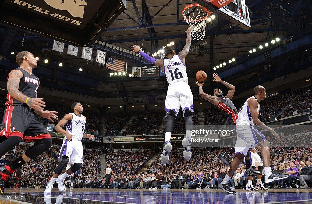 LeBron James of the Miami Heat passes against Ben McLemore of the Sacramento Kings on December 27 2013 at Sleep Train Arena in Sacramento California...