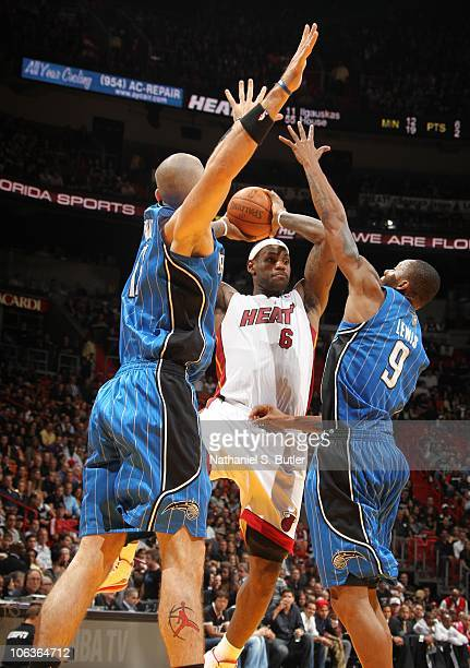 LeBron James of the Miami Heat passes against Marcin Gortat and Rashard Lewis of the Orlando Magic during a game on October 29 2010 at American...