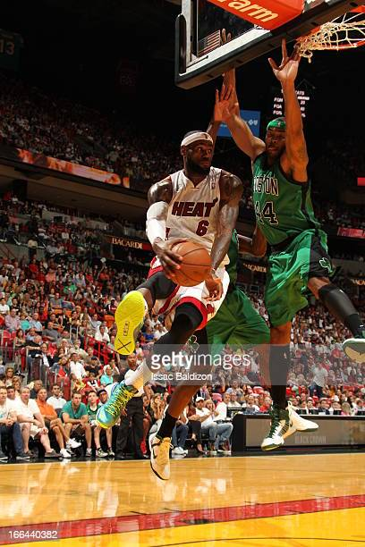 LeBron James of the Miami Heat passes the ball against Chris Wilcox of the Boston Celtics on April 12 2013 at American Airlines Arena in Miami...