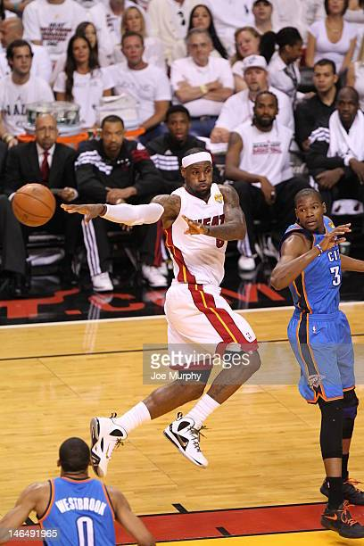 LeBron James of the Miami Heat passes the ball against Kevin Durant of the Oklahoma City Thunder during Game Three of the 2012 NBA Finals between the...