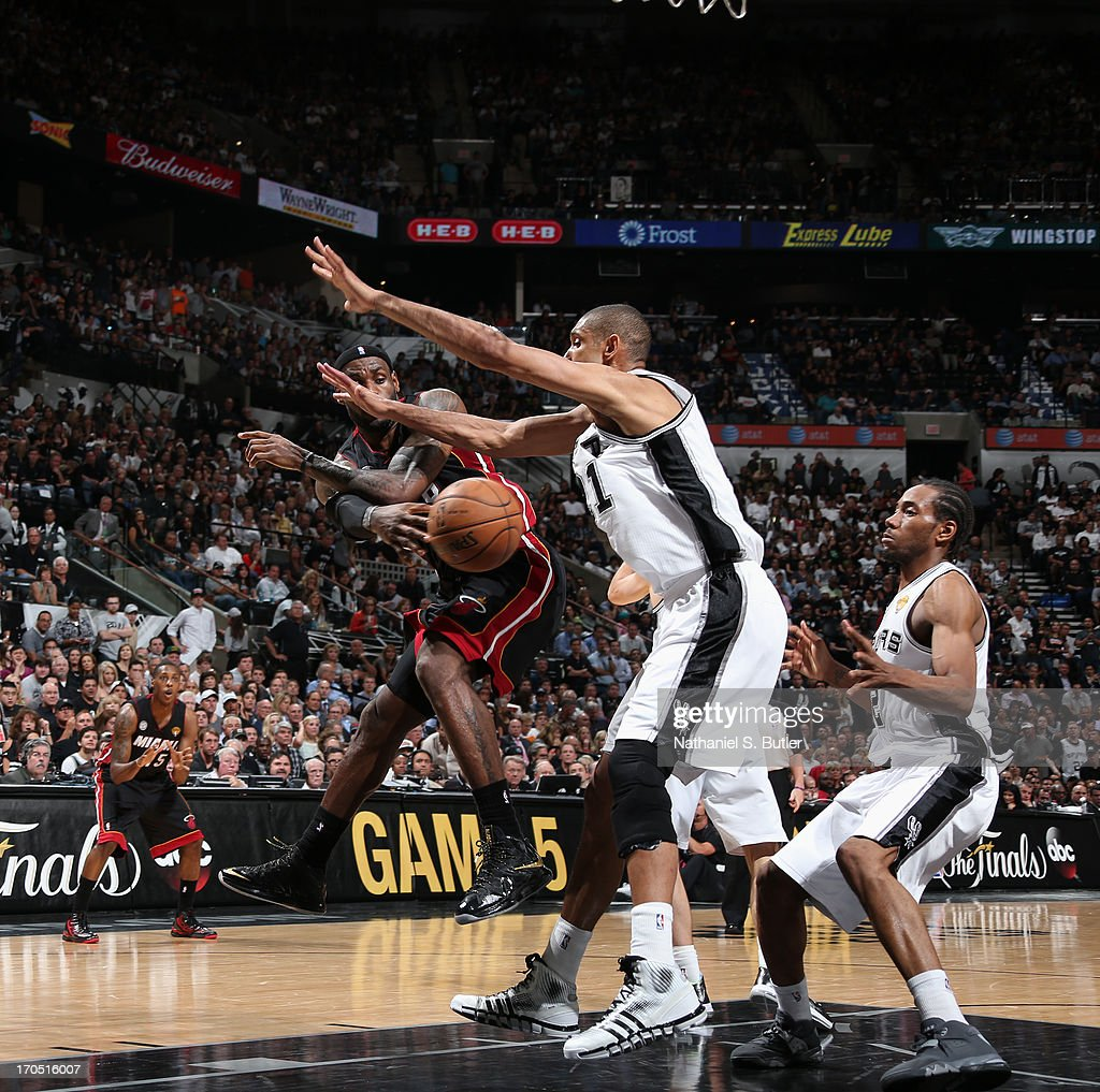 LeBron James #6 of the Miami Heat passes the ball around Tim Duncan #21 of the San Antonio Spurs during Game Four of the 2013 NBA Finals on June 13, 2013 at the AT&T Center in San Antonio, Texas.