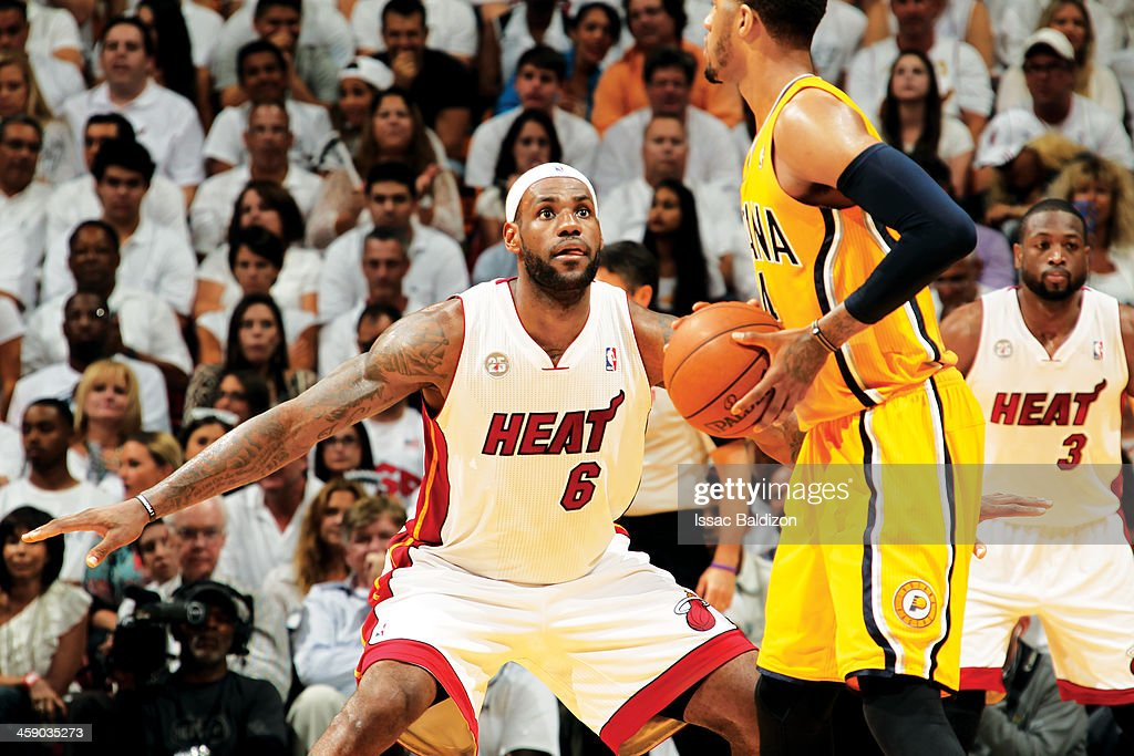 LeBron James of the Miami Heat plays defense against Paul George of the Indiana Pacers in Game Two of the Eastern Conference Finals during the 2013...