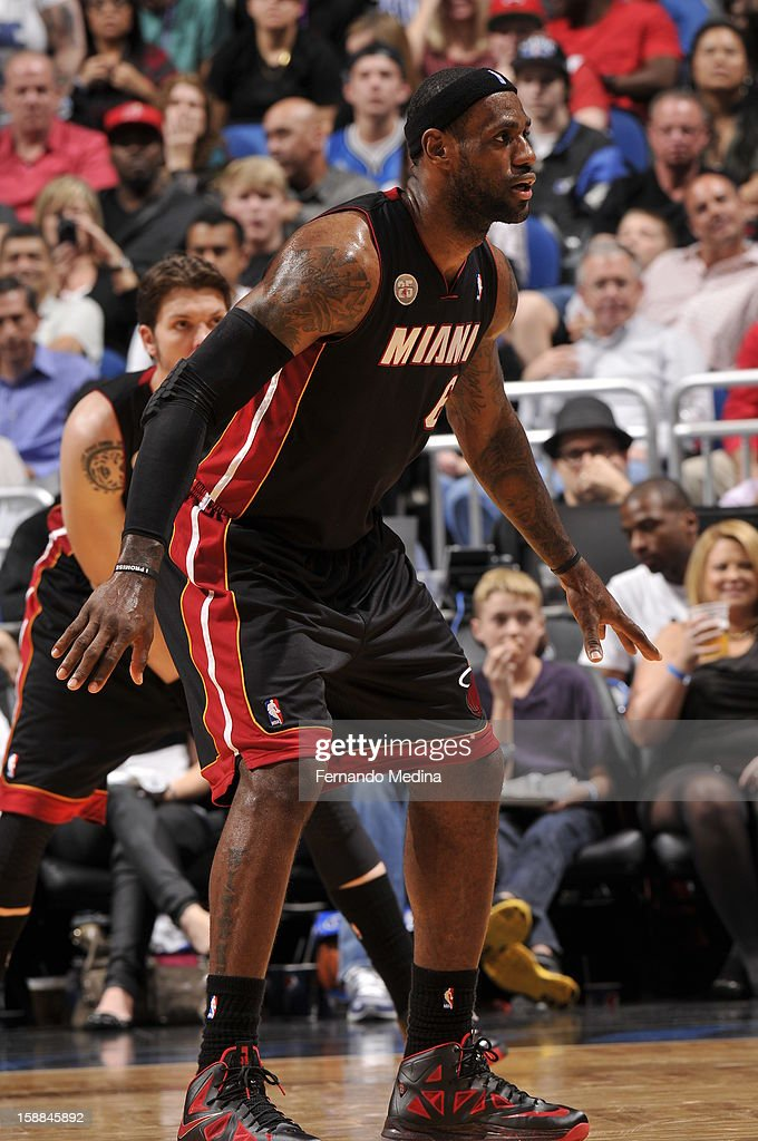 LeBron James #6 of the Miami Heat plays tight defense against the Orlando Magic during the game on December 31, 2012 at Amway Center in Orlando, Florida.