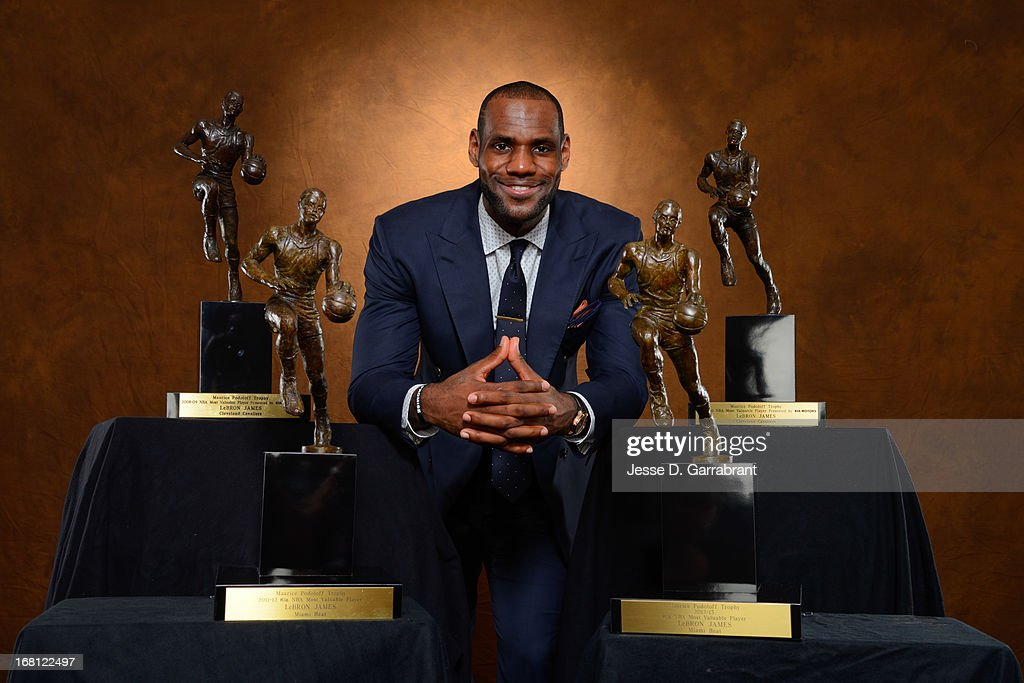 LeBron James #6 of the Miami Heat poses with his collection of Maurice Podoloff Trophies after being named the 2012-2013 Kia NBA Most Valuable Player (MVP) of the Year for the fourth time on May 5, 2013 at American Airlines Arena in Miami, Florida.