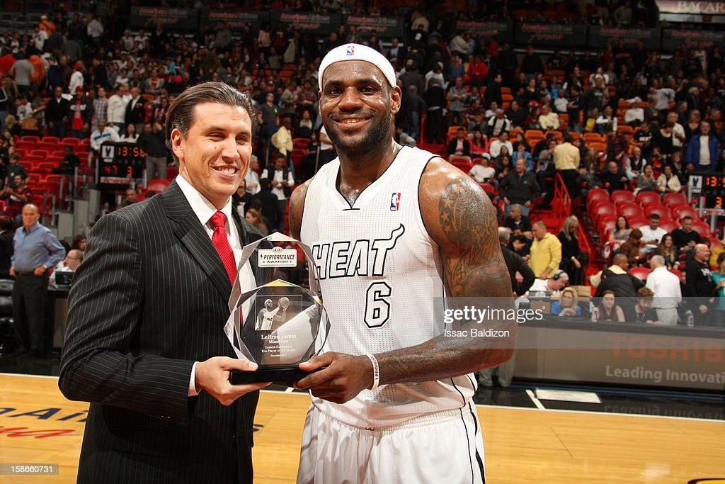 <a gi-track='captionPersonalityLinkClicked' href=/galleries/search?phrase=LeBron+James&family=editorial&specificpeople=201474 ng-click='$event.stopPropagation()'>LeBron James</a> #6 of the Miami Heat poses with his Kia performance award during the game between the Utah Jazz and the Miami Heat on December 22, 2012 at American Airlines Arena in Miami, Florida.