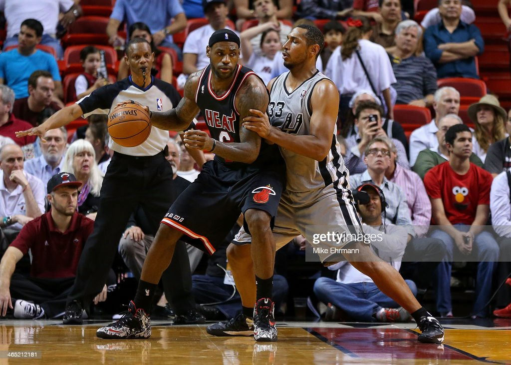 <a gi-track='captionPersonalityLinkClicked' href=/galleries/search?phrase=LeBron+James&family=editorial&specificpeople=201474 ng-click='$event.stopPropagation()'>LeBron James</a> #6 of the Miami Heat posts up <a gi-track='captionPersonalityLinkClicked' href=/galleries/search?phrase=Boris+Diaw&family=editorial&specificpeople=201505 ng-click='$event.stopPropagation()'>Boris Diaw</a> #33 of the San Antonio Spurs during a game at American Airlines Arena on January 26, 2014 in Miami, Florida.