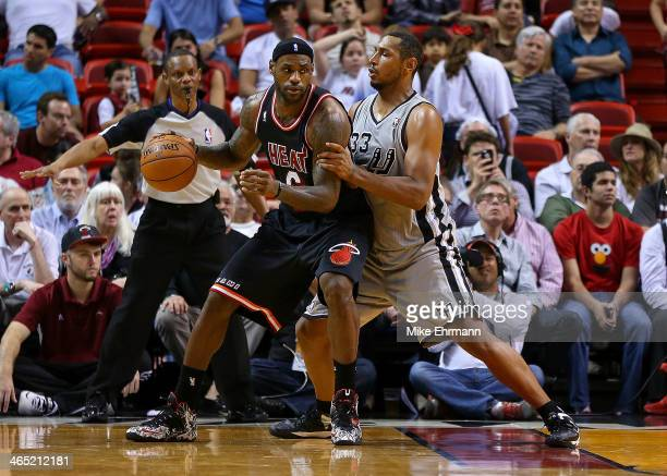 LeBron James of the Miami Heat posts up Boris Diaw of the San Antonio Spurs during a game at American Airlines Arena on January 26 2014 in Miami...