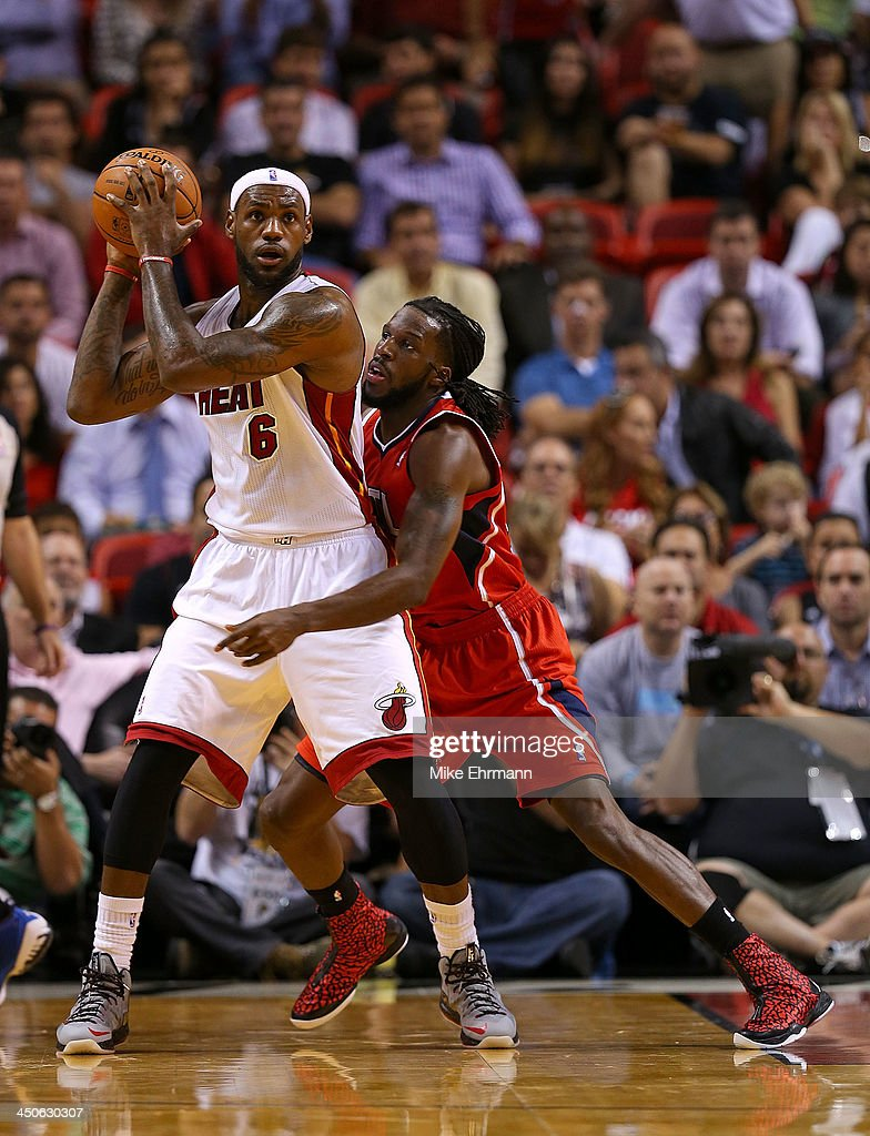 <a gi-track='captionPersonalityLinkClicked' href=/galleries/search?phrase=LeBron+James&family=editorial&specificpeople=201474 ng-click='$event.stopPropagation()'>LeBron James</a> #6 of the Miami Heat posts up <a gi-track='captionPersonalityLinkClicked' href=/galleries/search?phrase=DeMarre+Carroll&family=editorial&specificpeople=784686 ng-click='$event.stopPropagation()'>DeMarre Carroll</a> #5 of the Atlanta Hawks during a game at American Airlines Arena on November 19, 2013 in Miami, Florida.