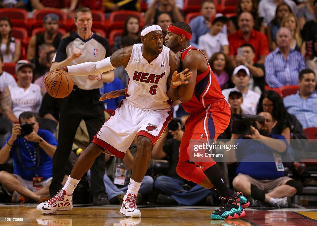<a gi-track='captionPersonalityLinkClicked' href=/galleries/search?phrase=LeBron+James&family=editorial&specificpeople=201474 ng-click='$event.stopPropagation()'>LeBron James</a> #6 of the Miami Heat posts up <a gi-track='captionPersonalityLinkClicked' href=/galleries/search?phrase=Josh+Smith+-+Basketballspieler+-+Jahrgang+1985&family=editorial&specificpeople=201983 ng-click='$event.stopPropagation()'>Josh Smith</a> #5 of the Atlanta Hawks during a game at American Airlines Arena on December 10, 2012 in Miami, Florida.