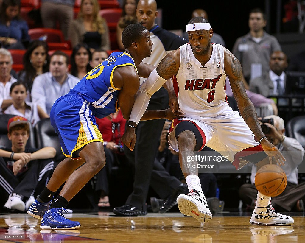 <a gi-track='captionPersonalityLinkClicked' href=/galleries/search?phrase=LeBron+James&family=editorial&specificpeople=201474 ng-click='$event.stopPropagation()'>LeBron James</a> #6 of the Miami Heat posts up <a gi-track='captionPersonalityLinkClicked' href=/galleries/search?phrase=Kent+Bazemore&family=editorial&specificpeople=6846101 ng-click='$event.stopPropagation()'>Kent Bazemore</a> #20 of the Golden State Warriors during a game at American Airlines Arena on December 12, 2012 in Miami, Florida.