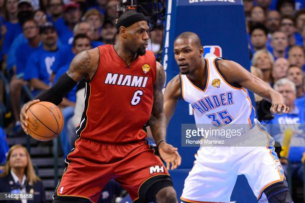 LeBron James of the Miami Heat posts up Kevin Durant of the Oklahoma City Thunder in the first quarter in Game One of the 2012 NBA Finals at...