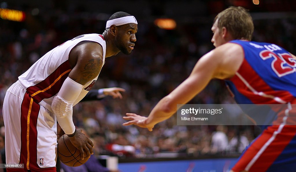 LeBron James #6 of the Miami Heat posts up Kyle Singler #25 of the Detroit Pistons during a game at American Airlines Arena on March 22, 2013 in Miami, Florida.