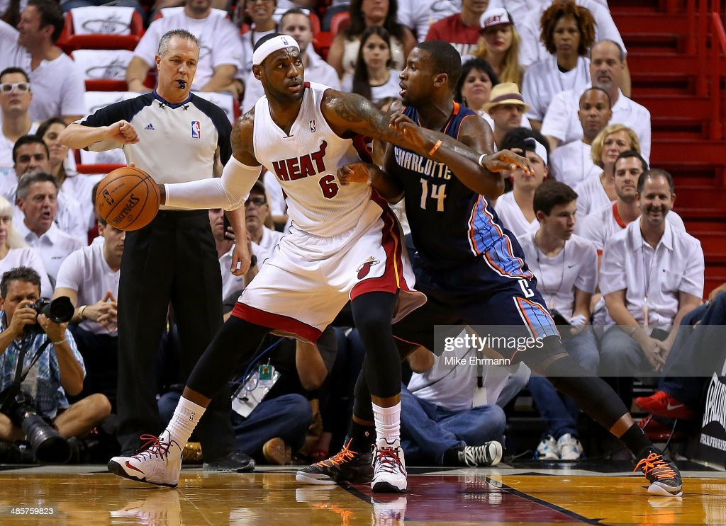 <a gi-track='captionPersonalityLinkClicked' href=/galleries/search?phrase=LeBron+James&family=editorial&specificpeople=201474 ng-click='$event.stopPropagation()'>LeBron James</a> #6 of the Miami Heat posts up <a gi-track='captionPersonalityLinkClicked' href=/galleries/search?phrase=Michael+Kidd-Gilchrist&family=editorial&specificpeople=8526214 ng-click='$event.stopPropagation()'>Michael Kidd-Gilchrist</a> #14 of the Charlotte Bobcats during Game 1 of the Eastern Conference Quarterfinals of the 2014 NBA Playoffs at American Airlines Arena on April 20, 2014 in Miami, Florida.