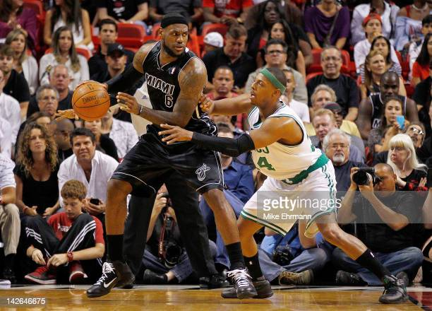 LeBron James of the Miami Heat posts up Paul Pierce of the Boston Celtics during a game at American Airlines Arena on April 10 2012 in Miami Florida...