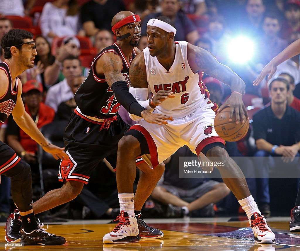 <a gi-track='captionPersonalityLinkClicked' href=/galleries/search?phrase=LeBron+James&family=editorial&specificpeople=201474 ng-click='$event.stopPropagation()'>LeBron James</a> #6 of the Miami Heat posts up Richard Hamilton #32 of the Chicago Bulls during a game at AmericanAirlines Arena on January 4, 2013 in Miami, Florida.