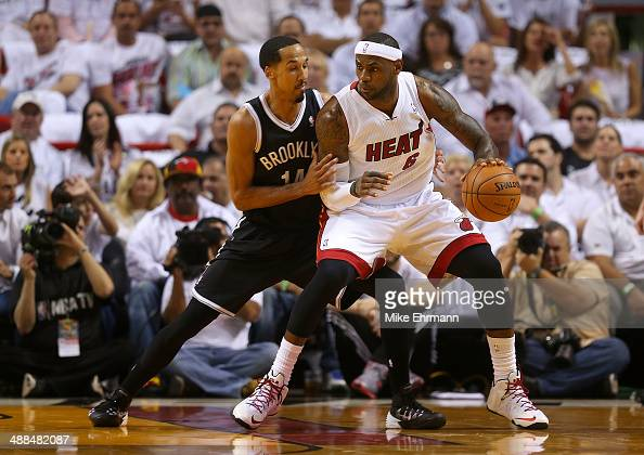 LeBron James of the Miami Heat posts up Shaun Livingston of the Brooklyn Nets during Game One of the Eastern Conference Semifinals of the 2014 NBA...