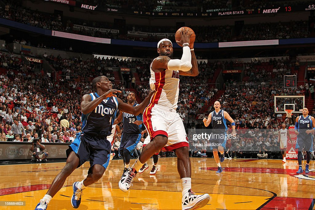 LeBron James #6 of the Miami Heat protects the ball Darren Collison #4 of the Dallas Mavericks on January 2, 2013 at American Airlines Arena in Miami, Florida.
