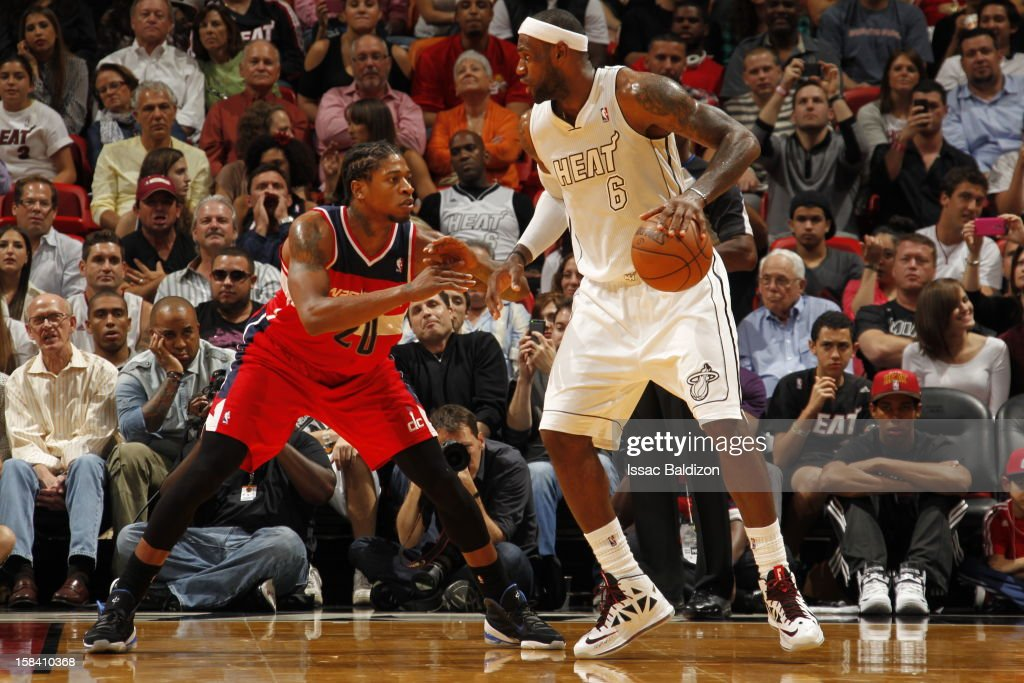 LeBron James #6 of the Miami Heat protects the ball from Cartier Martin #20 of the Washington Wizards during a game between the Washington Wizards and the Miami Heat on December 15, 2012 at American Airlines Arena in Miami, Florida.