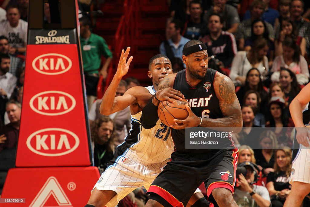 LeBron James #6 of the Miami Heat protects the ball from Moe Harkless #21 of the Orlando Magic during the game between the Orlando Magic and the Miami Heat on March 6, 2013 at American Airlines Arena in Miami, Florida.