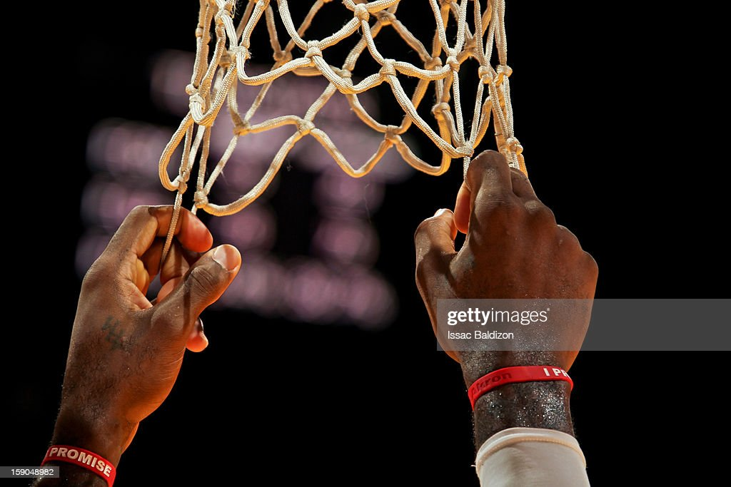 <a gi-track='captionPersonalityLinkClicked' href=/galleries/search?phrase=LeBron+James&family=editorial&specificpeople=201474 ng-click='$event.stopPropagation()'>LeBron James</a> #6 of the Miami Heat pulls on the net during a game against the Washington Wizards on January 6, 2013 at American Airlines Arena in Miami, Florida.
