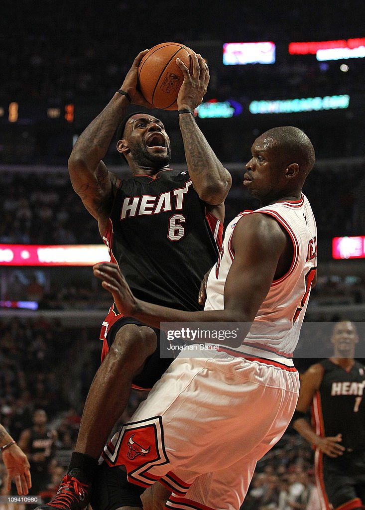 <a gi-track='captionPersonalityLinkClicked' href=/galleries/search?phrase=LeBron+James&family=editorial&specificpeople=201474 ng-click='$event.stopPropagation()'>LeBron James</a> #6 of the Miami Heat puts up a shot against Loul Deng #9 of the Chicago Bulls at the United Center on February 24, 2011 in Chicago, Illinois.