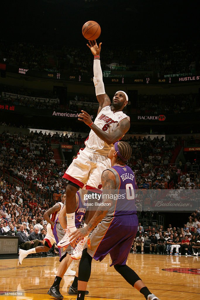 LeBron James #6 of the Miami Heat puts up a shot over Michael Beasley #0 of the Phoenix Suns on November 5, 2012 at American Airlines Arena in Miami, Florida.