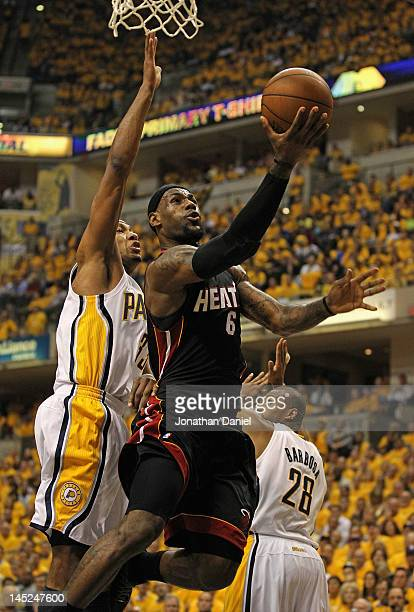 LeBron James of the Miami Heat puts up a shot past Danny Granger and Leandro Barbosa of the Indiana Pacers in Game Six of the Eastern Conference...