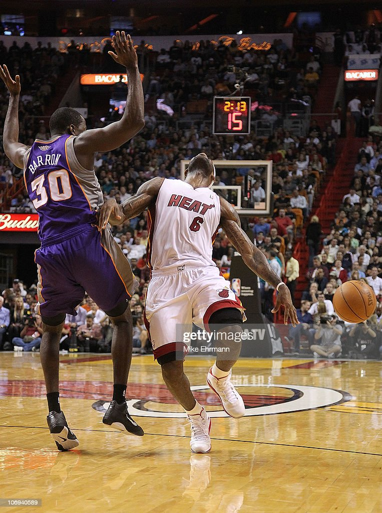 <a gi-track='captionPersonalityLinkClicked' href=/galleries/search?phrase=LeBron+James&family=editorial&specificpeople=201474 ng-click='$event.stopPropagation()'>LeBron James</a> #6 of the Miami Heat reacts after being fouled by <a gi-track='captionPersonalityLinkClicked' href=/galleries/search?phrase=Earl+Barron&family=editorial&specificpeople=234747 ng-click='$event.stopPropagation()'>Earl Barron</a> #30 during a game against the Phoenix Suns at American Airlines Arena on November 17, 2010 in Miami, Florida.