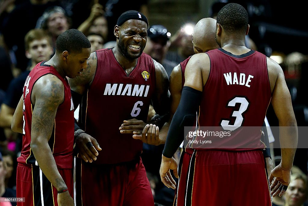 <a gi-track='captionPersonalityLinkClicked' href=/galleries/search?phrase=LeBron+James&family=editorial&specificpeople=201474 ng-click='$event.stopPropagation()'>LeBron James</a> #6 of the Miami Heat reacts after cramping up against the San Antonio Spurs during Game One of the 2014 NBA Finals at the AT&T Center on June 5, 2014 in San Antonio, Texas.