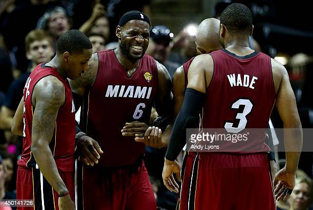 LeBron James of the Miami Heat reacts after cramping up against the San Antonio Spurs during Game One of the 2014 NBA Finals at the ATT Center on...