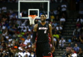 LeBron James of the Miami Heat reacts after defeating the Charlotte Bobcats 10998 in Game Four of the Eastern Conference Quarterfinals during the...