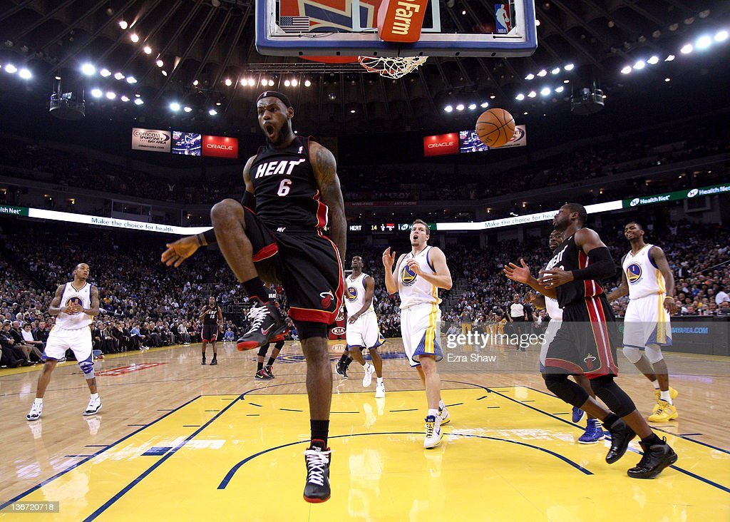 <a gi-track='captionPersonalityLinkClicked' href=/galleries/search?phrase=LeBron+James&family=editorial&specificpeople=201474 ng-click='$event.stopPropagation()'>LeBron James</a> #6 of the Miami Heat reacts after dunking the ball against the Golden State Warriors at Oracle Arena on January 10, 2012 in Oakland, California.
