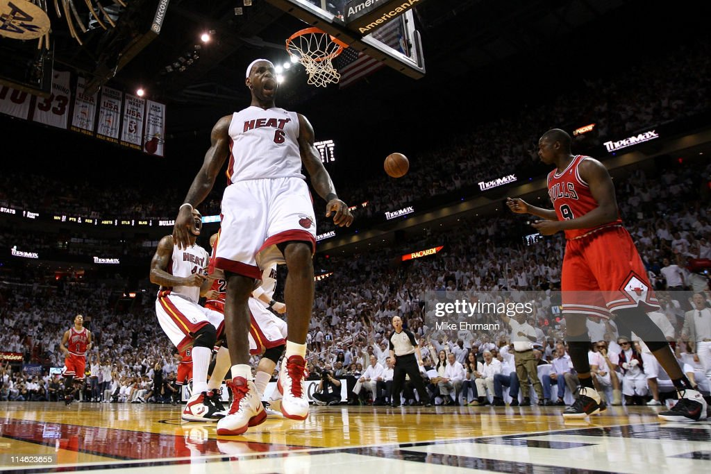 LeBron James #6 of the Miami Heat reacts after he dunked against Luol Deng #9 of the Chicago Bulls in the second half of Game Four of the Eastern Conference Finals during the 2011 NBA Playoffs on May 24, 2011 at American Airlines Arena in Miami, Florida.