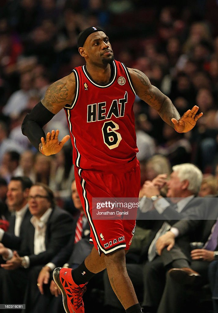 <a gi-track='captionPersonalityLinkClicked' href=/galleries/search?phrase=LeBron+James&family=editorial&specificpeople=201474 ng-click='$event.stopPropagation()'>LeBron James</a> #6 of the Miami Heat reacts after hitting a shot against the Chicago Bulls at the United Center on February 21, 2013 in Chicago, Illinois. The Heat defeated the Bulls 86-67.