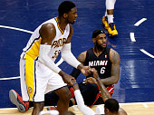 LeBron James of the Miami Heat reacts against the Indiana Pacers during Game Five of the Eastern Conference Finals of the 2014 NBA Playoffs at...