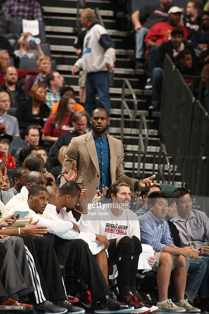LeBron James #6 of the Miami Heat reacts on the bench during the game against the Charlotte Bobcats at the Time Warner Cable Arena on April 5, 2013 in Charlotte, North Carolina.