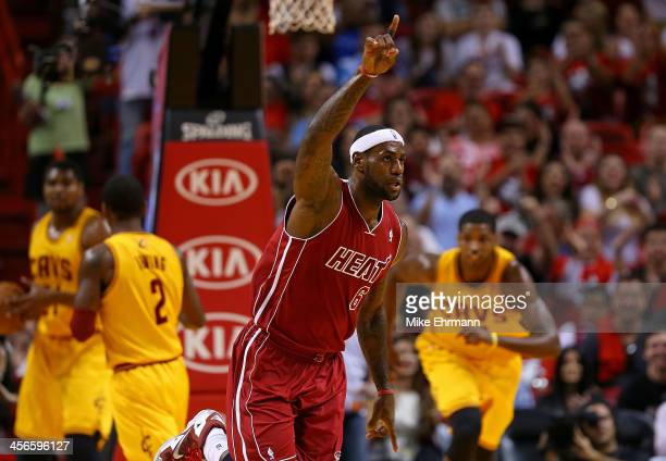 LeBron James of the Miami Heat reacts to a play during a game against the Cleveland Cavaliers at American Airlines Arena on December 14 2013 in Miami...