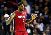 LeBron James of the Miami Heat reacts to the crowd during their game against the Charlotte Bobcats at Time Warner Cable Arena on January 18 2014 in...