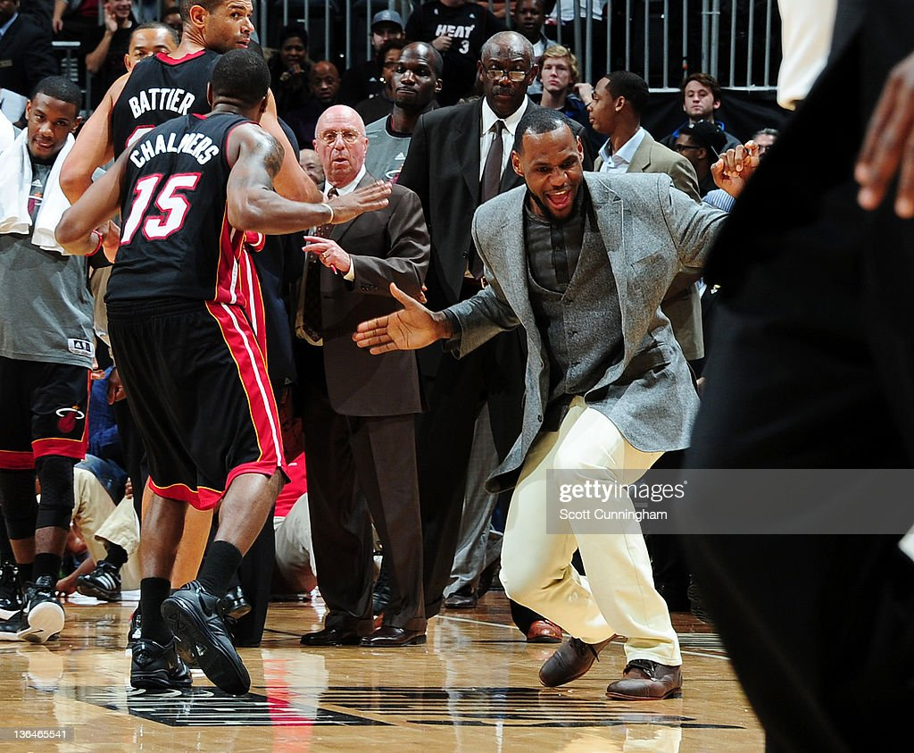 <a gi-track='captionPersonalityLinkClicked' href=/galleries/search?phrase=LeBron+James&family=editorial&specificpeople=201474 ng-click='$event.stopPropagation()'>LeBron James</a> #6 of the Miami Heat (right) reacts tot he game action during the game against the Atlanta Hawks on January 5, 2012 at Philips Arena in Atlanta, Georgia.