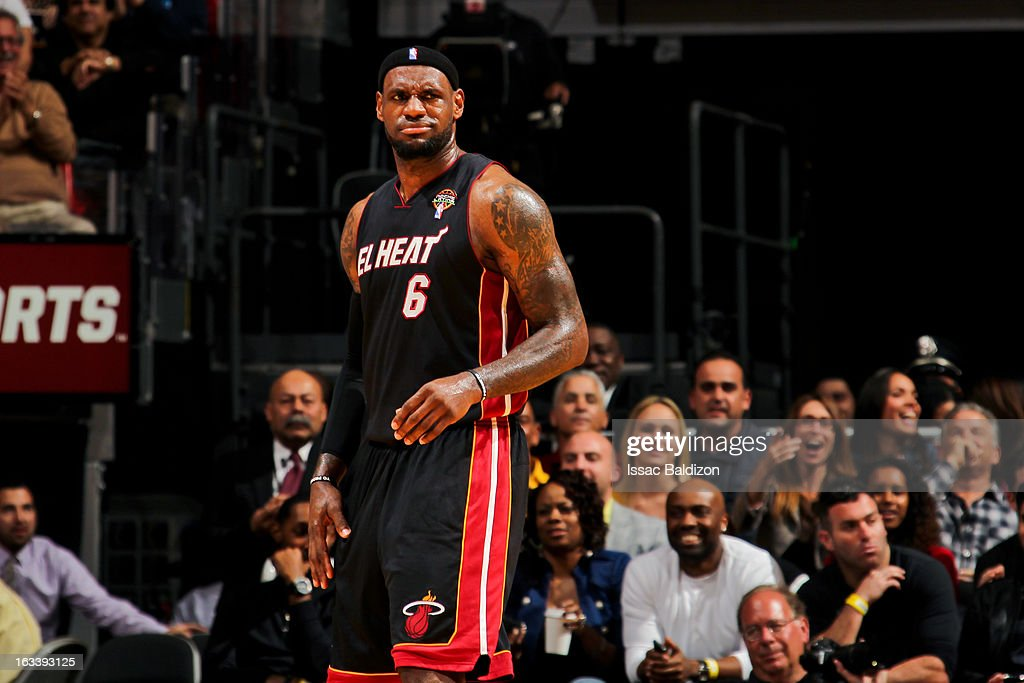 LeBron James #6 of the Miami Heat reacts while playing against the Philadelphia 76ers on March 8, 2013 at American Airlines Arena in Miami, Florida.