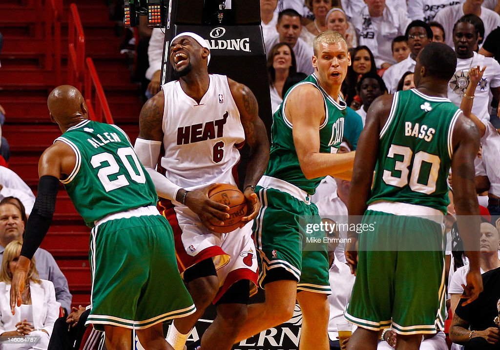 <a gi-track='captionPersonalityLinkClicked' href=/galleries/search?phrase=LeBron+James&family=editorial&specificpeople=201474 ng-click='$event.stopPropagation()'>LeBron James</a> #6 of the Miami Heat reacts with the ball between <a gi-track='captionPersonalityLinkClicked' href=/galleries/search?phrase=Ray+Allen&family=editorial&specificpeople=201511 ng-click='$event.stopPropagation()'>Ray Allen</a> #20 and <a gi-track='captionPersonalityLinkClicked' href=/galleries/search?phrase=Greg+Stiemsma&family=editorial&specificpeople=2098297 ng-click='$event.stopPropagation()'>Greg Stiemsma</a> #54 of the Boston Celtics in the first half in Game Seven of the Eastern Conference Finals in the 2012 NBA Playoffs on June 9, 2012 at American Airlines Arena in Miami, Florida.