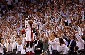 LeBron James of the Miami Heat recats to winning Game Five of the Eastern Conference Semifinals of the 2014 NBA Playoffs against the Brooklyn Nets at...