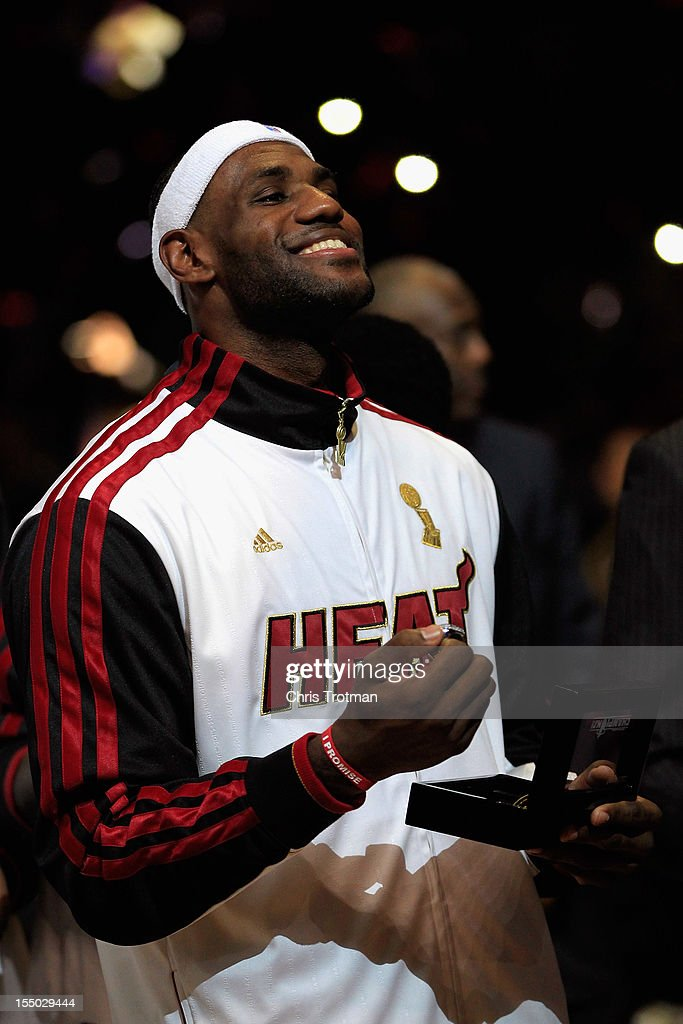 LeBron James #6 of the Miami Heat receives his 2012 NBA Championship ring following a ceremony prior to the game against the Boston Celtics at American Airlines Arena on October 30, 2012 in Miami, Florida.