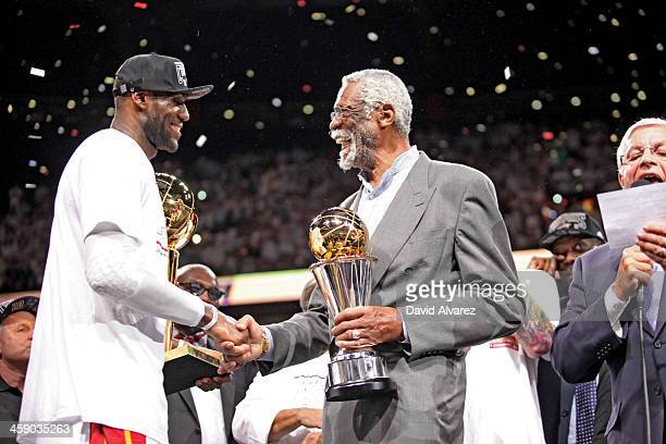 LeBron James of the Miami Heat receives the Bill Russell NBA Finals Most Valuable Player trophy from NBA legend Bill Russell following the Heat's...