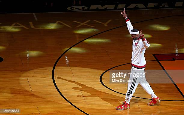 LeBron James of the Miami Heat recieves his 2013 Championship Ring during a game against the Chicago Bulls at American Airlines Arena on October 29...