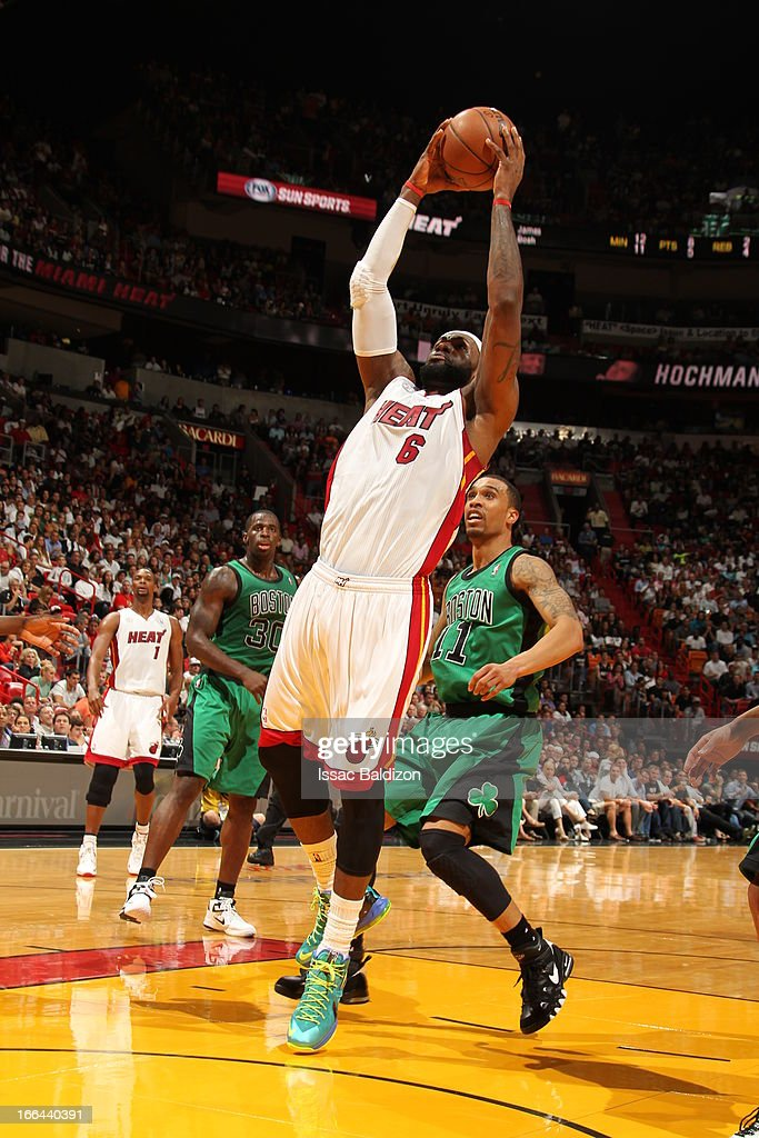 LeBron James #6 of the Miami Heat rises for a dunk against Courtney Lee #11 of the Boston Celtics on April 12, 2013 at American Airlines Arena in Miami, Florida.